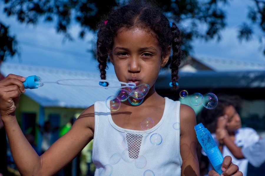 Girl blowing bubbles at Holiday Events in Naperville